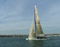 America's Cup challenger at full sail in San Diego Harbor.